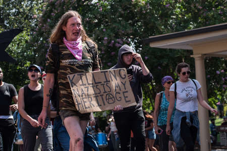 Charlottesville, Virginia USA August 12, 2017 Transgender veteran activist protesting Unite the Right rally, solidarity in support of Robert E Lee confederate statue and to show strength in numbers Editorial