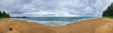 panoramic beach: An emty panoramic beach in cloudy day after rainning Stock Photo