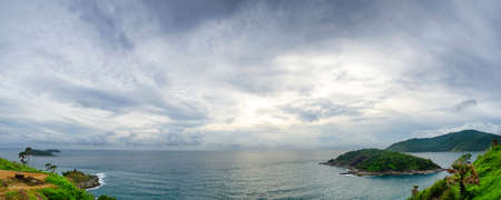 chapmans: cloudy panoramic cape and sun behind the cloud.