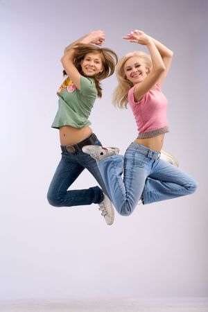 Synchronously jump two women