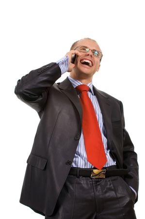 Happy the man in a business suit talks by a mobile phone on a white background. Image isolated my studio. photo