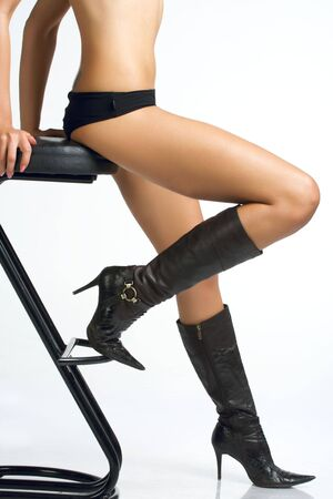 Portrait uality legs women sitting on a bar stool.