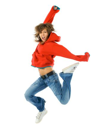 sport wear: Studio isolated. Dancing woman in red with brown long hair and happy smiling facial expression jumping up.