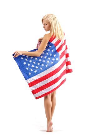 Young woman with blonde long hair  in American flag stand tiptoe on a white backgrund