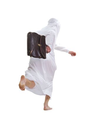Arab holds a briefcase of business and runs away from the camera (without a face). Isolation on a white background in the studio. photo
