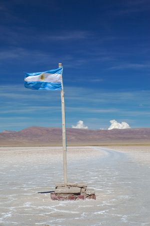 Photo of the Argentine flag in salt lake photo