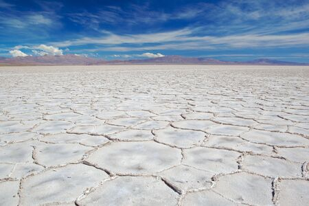 Image of salt flats and blue sky with white clouds