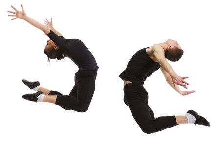 One young woman and one young man in black sportswear jumping together. Studio isolated in white background. photo
