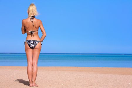 Photo girls on the beach. is back. This image ideal for your text.