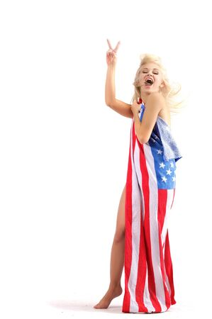 american sexy girl: Standing woman (resembles Marilyn) with American flag and happy smiling facial expression. Victory sign.