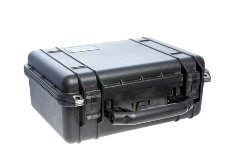 watertight: Case for protecting equipment. Studio shot. Isolation on white background. Side view. Stock Photo