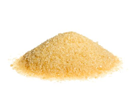 A pile of brown sugar isolated on a white background photo