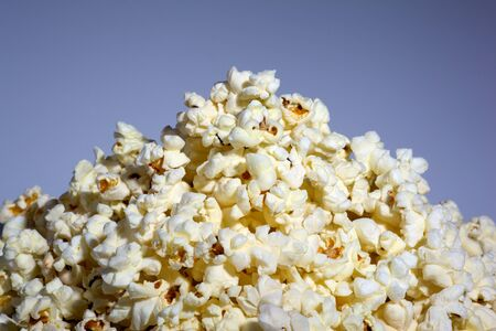 popped: A top of the heap popped popcorn on a blue background