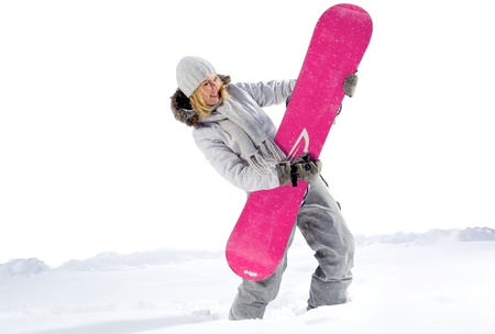 snowboard: Young woman very expressive emotion with a snowboard, like a guitar isolated on a white background. Outdoor studio shot with snow in winter.