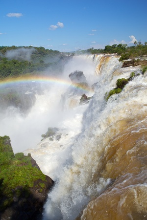 descends: Scenic view of Iguazu waterfall, Brazil and Argentinian border.