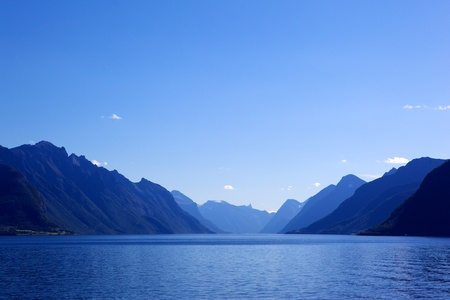 Image of sea and mountains landscape with blue gradient color.