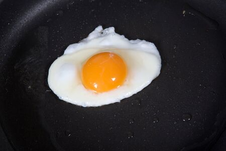 whites: A fried egg in a frying pan  Stock Photo