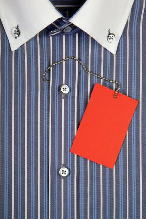 Blue men's shirt with white collar and red label on iron rope photo