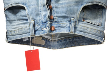 Blue mens jeans hang and red label on iron rope Stock Photo