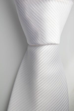 Close up knot of white tie