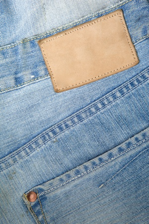 leather label: Blue mens jeans with blank leather label