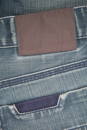 Blue mens jeans with blank leather label photo