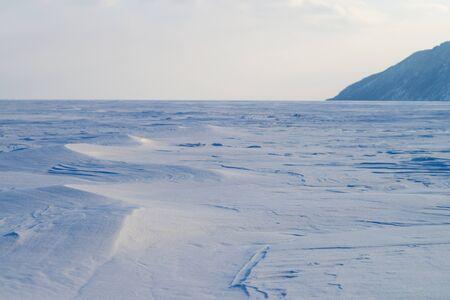 frozen lake: Snow-covered frozen lake Stock Photo