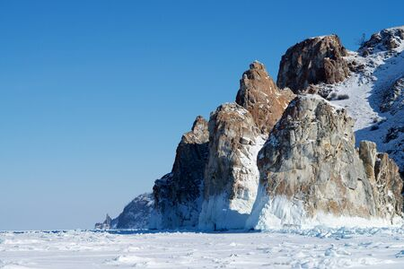 Winter landscape of mountains and frozen lake Baikal Stock Photo