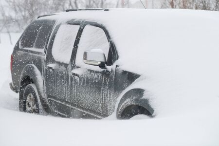 extreme weather: A car buried in snow in the winter. Stock Photo