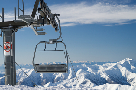 A cableway on a ski resort on a snowy mountain. Stock Photo