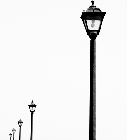 overtaken: Old style lamp posts with energy saving light bulbs  Bringing the past into the future