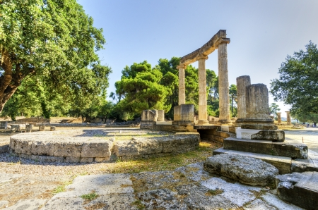 Ruins of the ancient site of Olympia, specifically the Philippeion in the Altis of Olympia. Stock Photo