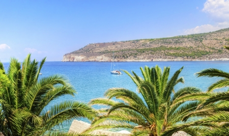 The beautiful Greek coastline with crystal clear waters photo