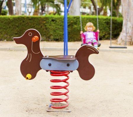 A view of a chidren's rocking playground toy dog Stock Photo - 20051505