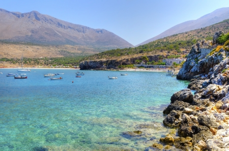 The beautiful Greek coastline with crystal clear water photo