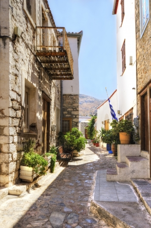 A picturesque alley on the Greek island Hydra, which depicts some of the local architecture  Stock Photo