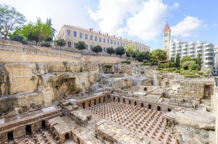 A view of the archaeological ruins of the ancient roman baths discovered in downtown Beirut, in Lebanon, surrounded by modern buildings and Saint Louis Des Capucins cathedral in the bacground