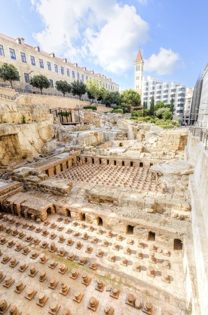 beirut: A view of the archaeological ruins of the ancient roman baths discovered in downtown Beirut, in Lebanon, surrounded by modern buildings  Stock Photo