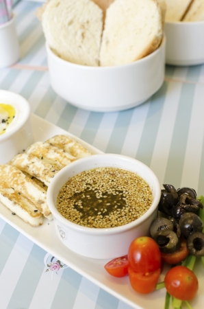 atar: A very healthy Lebanese breakfast with bread, zaatar spread, hallumi cheese, olives and tomatoes  Very typical dish of lebanon and Mediterranean cuisine