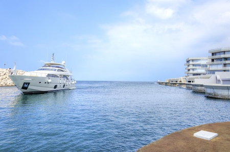 embarked: A yacht entering the beautiful Marina in Zaitunay Bay in Beirut, Lebanon  A very modern, high end and newly developed area where yachts are embarked and it
