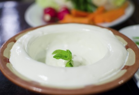 Lebanese food starter, labneh topped with mint leaves  A photo of a very typical dish of Lebanon and Mediterranean cuisine