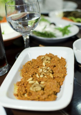 Lebanese food starter, muhammara topped with pine nuts  A photo of a very typical dish of Lebanon and Mediterranean cuisine