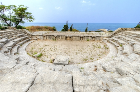 A view of the ancient Roman theatre situated in the historic city of Byblos in Lebanon overlooking the mediterranean sea, located at the crusaders photo