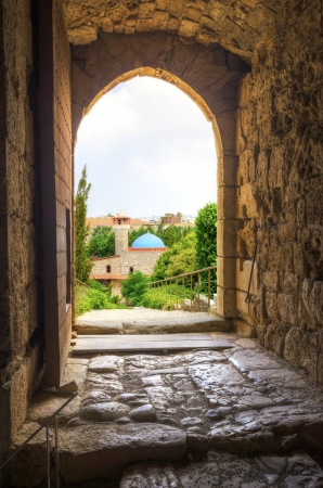 The historic city of  Byblos in Lebanon viewed from the gate entrance of the crusaders Stock Photo