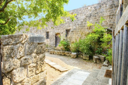 A part of the crusaders castle in the ancient city of Byblos in Lebanon. A view of the exterior and the entrance leading into the main part of the dwelling. photo