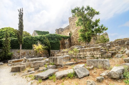 The crusaders castle in the historic city of Byblos in Lebanon. A view of the exterior and the western part of the ancient site. photo