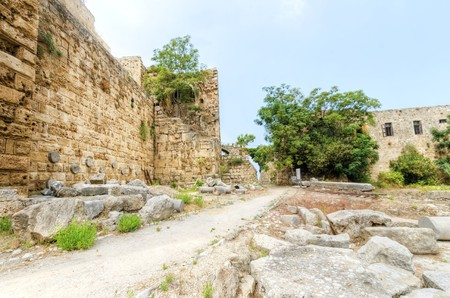 The crusaders castle in the historic city of Byblos in Lebanon. A view of the northern walls and the Roman Nympheum discovered at the ancient site. photo