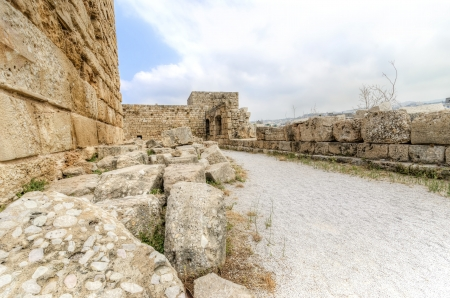 The exterior of the crusaders' castle in the historic city of Byblos in Lebanon. A view of the southern part of the castle, the walls and towers of the castle into the courtyard. photo
