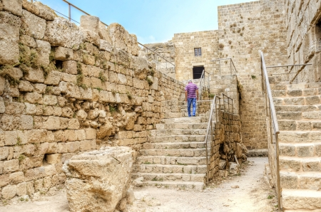 The exterior of the crusaders' castle in the historic city of Byblos in Lebanon. A view of the southern part of the castle and a staircase leading to the interior where the museum is situated. photo