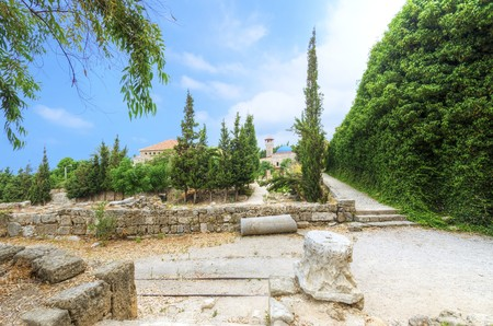 The historic city of  Byblos in Lebanon viewed from the crusaders castle. A view of the mosque and the path leading to the castle entrance. photo